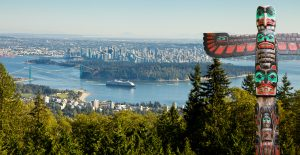 Vancouver as seen from view point. First nation totem pole in Vancouver.